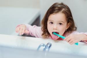 little girl brushing her tongue in Guelph